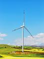 Wind turbine on hill against blue sky - PhotoDune Item for Sale