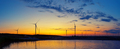 Wind generators power plant on lake at sunset - PhotoDune Item for Sale