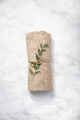 Green branch and SPA towel on white marble background - PhotoDune Item for Sale