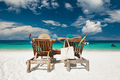 Couple in green relax on a beach at Maldives - PhotoDune Item for Sale