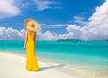 Woman in dress walking on tropical beach - PhotoDune Item for Sale