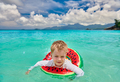 Toddler boy on beach swimming with inflatable ring - PhotoDune Item for Sale