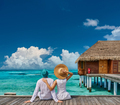 Couple in white on a tropical beach jetty - PhotoDune Item for Sale