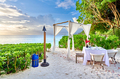 Table set up for romantic dinner on beach at Seychelles - PhotoDune Item for Sale