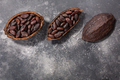 Split fermented cocoa pod with shelled cacao beans atop grey, top view, copy space - PhotoDune Item for Sale