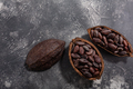 Split fermented cocoa pod with shelled cacao beans atop dark grey backdrop,  top view - PhotoDune Item for Sale