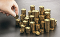 Rich man stacking golden money coins. Income saving plan. - PhotoDune Item for Sale