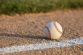 Low angle selective focus view of a baseball on a basepath with white stripe - PhotoDune Item for Sale