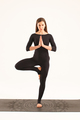 fitness muscular woman doing yoga isolated on studio background - PhotoDune Item for Sale