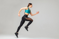 side view of athletic running woman - PhotoDune Item for Sale