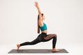 athletic muscular woman doing yoga exercise studio photo - PhotoDune Item for Sale