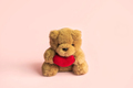 Cute teddy bear with red heart on color background and copy space, Valentine's Day concept - PhotoDune Item for Sale