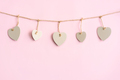 Wooden heart on rope with pastel color background and copy space, Valentine's Day concept - PhotoDune Item for Sale