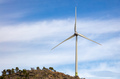 Wind turbine, renewable energy on a rocky hill. - PhotoDune Item for Sale