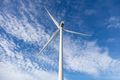 Wind turbine, renewable energy on blue cloudy sky background - PhotoDune Item for Sale