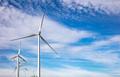 Wind turbines, renewable energy on  blue cloudy sky background. Wind farm - PhotoDune Item for Sale
