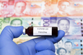 Vaccine against Covid-19 on the background of Philippine peso - PhotoDune Item for Sale