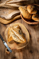 Fresh bread rolls on a rustic wooden table. - PhotoDune Item for Sale