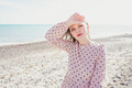 Young woman wearing a pink dress at the beach - PhotoDune Item for Sale