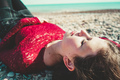 Young and trendy woman in a sunny day sitting on the beach - PhotoDune Item for Sale