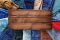 Denim jeans on old wooden background texture table surface - PhotoDune Item for Sale