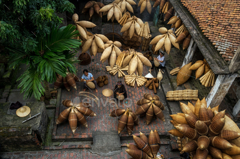 Top view of Group of Old Vietnamese female craftsman making the traditional bamboo fish