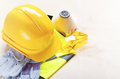 Yellow plastic hard hat, glasses, respirator, reflective vest and protective gloves - PhotoDune Item for Sale