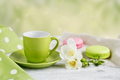 Cup of black coffee, white freesia flowers and sweet pastel french macaroons - PhotoDune Item for Sale