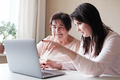 Mom and daughter use a laptop - PhotoDune Item for Sale