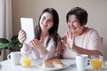 Grandmother and granddaughter use a tablet - PhotoDune Item for Sale