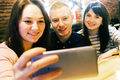 Friends taking a selfie in a cafe - PhotoDune Item for Sale