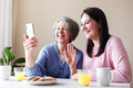 Elderly and young women use video calling - PhotoDune Item for Sale