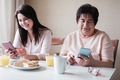 Grandmother and granddaughter use phones - PhotoDune Item for Sale