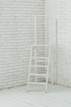 Interior with white ladder and a white brick wall - PhotoDune Item for Sale