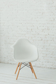 Interior with white modern chair and a white brick wall - PhotoDune Item for Sale