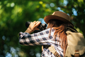Happy freedom young woman watching wildlife with binoculars in nature park autumn, travel concept. - PhotoDune Item for Sale