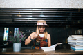 Woman is holding a cup of hot coffee and reading a book, Business woman read a book in coffee shop. - PhotoDune Item for Sale