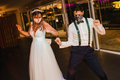 Young couple with surgical masks dancing on their wedding - PhotoDune Item for Sale