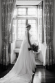 Bride on her wedding dress in front of a window - PhotoDune Item for Sale