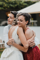 Bridesmaid hugging a young couple at the wedding - PhotoDune Item for Sale