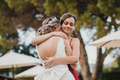 Bridesmaid hugging the bride at the wedding - PhotoDune Item for Sale