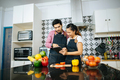 Happy young couple is using digital to looking method to cooking while cooking in kitchen at home. - PhotoDune Item for Sale