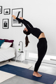 Young slim Woman practicing yoga in modern minimalistic bedroom - PhotoDune Item for Sale