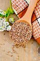 Buckwheat in spoon on board with flower and doily - PhotoDune Item for Sale