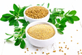 Fenugreek in two bowls with leaves on white board - PhotoDune Item for Sale