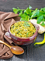 Kitchari in bowl on dark wooden board - PhotoDune Item for Sale