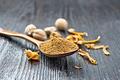 Nutmeg round in spoon on board - PhotoDune Item for Sale