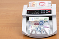 Mexican money in the counting machine - PhotoDune Item for Sale