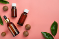 Dropper bottles with macadamia nut essential oil on pink background flat lay design with copy-space - PhotoDune Item for Sale