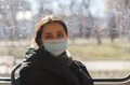 young beautiful woman in medicine face mask in city transport, pandemic life - PhotoDune Item for Sale